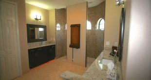 Master bathroom with walk in shower with waterfall feature & Travertine flooring...