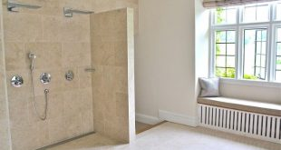 This is the shower, built for two, with drenching waterfalls, no doors; marble f...