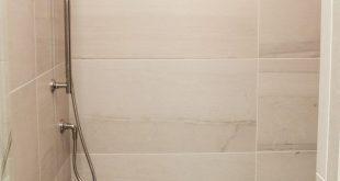 12x24 wall tile grid pattern in walk-in shower niche