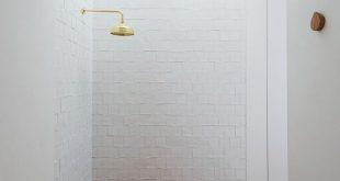 Impressive recessed bathtub with terra cotta tiles