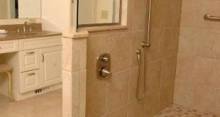 Remodeled bathroom with walk-in shower by Neal's Design Remodel. #BathroomShower...