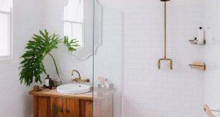 Scandinavian bathroom with patterned pink floor tile and walk-in shower #bathroo...