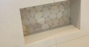 Woman's shaving niche custom . . #niche#custom#showers#tile#stone#art#design#w...